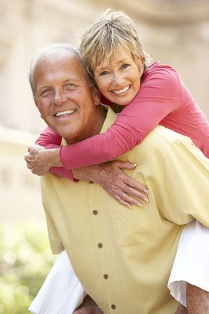 Senior Couple Having Fun In City photo