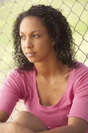 Teenage Girl Sitting In Playground photo