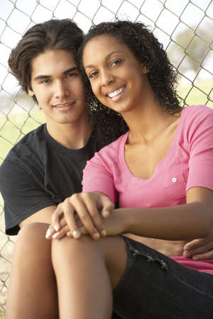 19 year old boy: Teenage Couple Sitting In Playground