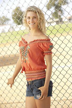 Teenage Girl Sitting In Playground Stock Photo - 6451638