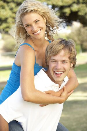 19 year old boy: Teenage Couple Having Fun In Playground Stock Photo