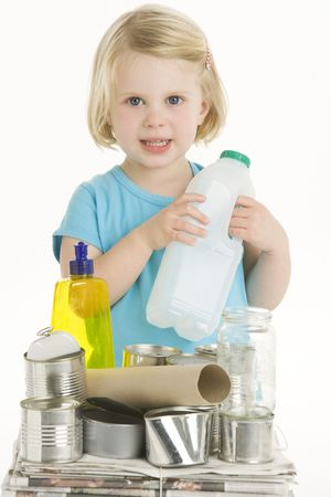 Child Holding Recycling photo
