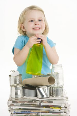 reusing: Child Helping With Recycling Stock Photo