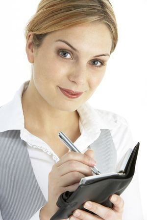 Blonde Businesswoman Writing In Diary photo