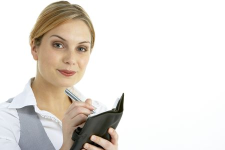 Businesswoman Writing In Diary photo