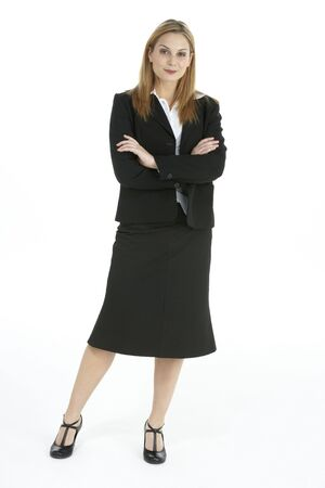 Full Length Studio Portrait Of Female Executive photo