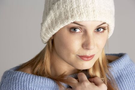 Portrait Of Pretty Young Woman Dressed For Winter photo