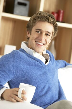 Young Man Relaxing With Cup Of Coffee photo