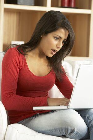 Shocked Woman Using Laptop photo