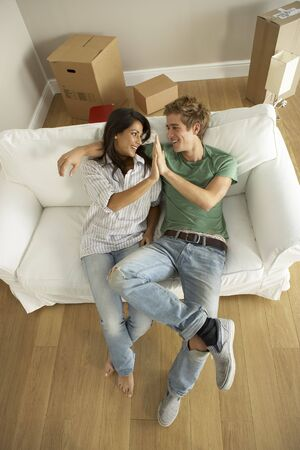 attractive couch: Couple moving into new home