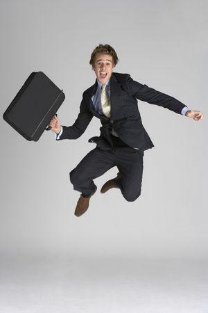 persona saltando: Empresario salto en el aire Foto de archivo