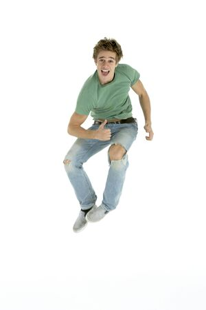 Young Man Jumping In Air photo
