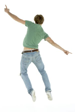 man flying: Back View Of Man Jumping In Air