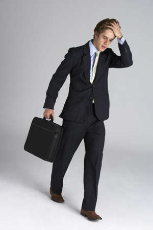Worried Looking Executive With Briefcase photo