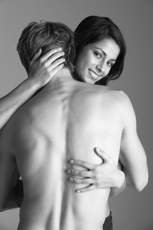 Naked Young Couple Embracing Stock Photo - 6453565