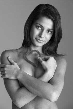 Naked Woman Holding Heart Shape photo