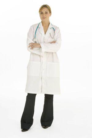 Full Length Shot Of Female Doctor Against White Background Stock Photo