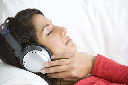 woman relaxing: Woman Relaxing Listening To Music Wearing Headphones
