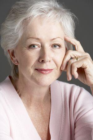 attractive lady: Studio Portrait Of Smiling Senior Woman