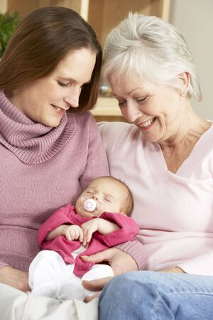 Portrait Of Grandmother, Mother And Daughter At Home photo