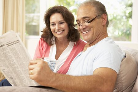 Senior Couple Reading Newspaper At Home Stock Photo - 6453420