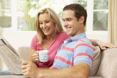 Couple Reading Newspaper At Home photo