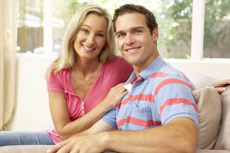 Young Couple Relaxing On Sofa At Home photo