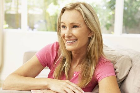 Woman Relaxing On Sofa At Home Stock Photo - 6453398