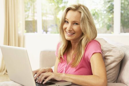 Young Woman Using Laptop At Home photo