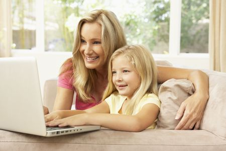 Mother And Daughter Using Laptop At Home Stock Photo - 6453205