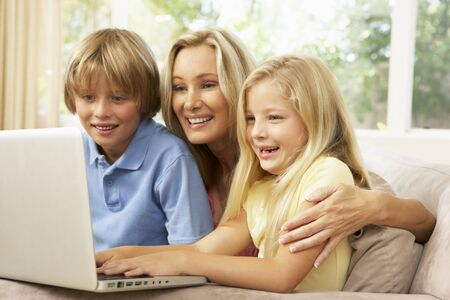 Mother And Children Using Laptop At Home photo