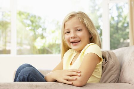 Young Girl Relaxing On Sofa At Home photo