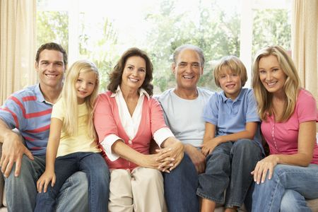 extended: Extended Family Relaxing At Home Together Stock Photo