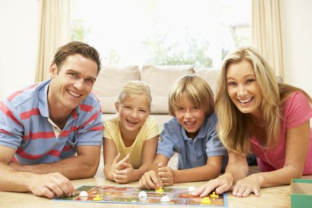 game room: Family Playing Board Game At Home