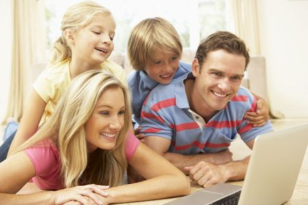 Family Using Laptop At Home Together photo