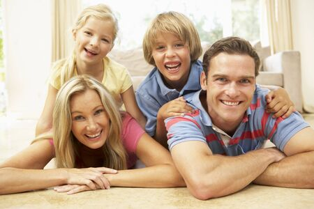 family room: Family Having Fun At Home Together Stock Photo