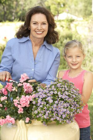Grandmother With Granddaughter Gardening Together Stock Photo - 6452641