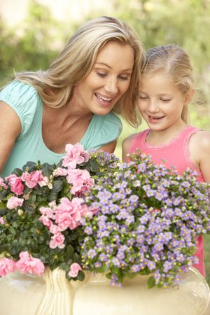 Woman With Daughter Gardening Together photo