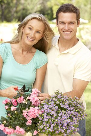 40s: Young Couple Gardening Stock Photo