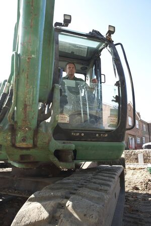 Construction Worker Using Digger photo