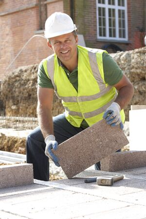 home safety: Construction Worker Laying Blockwork