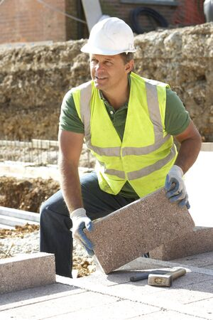 Construction Worker Laying Blockwork photo