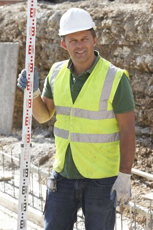 fourties: Construction Worker Laying Foundations