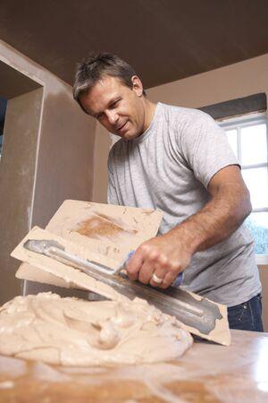 plastering: Plasterer Mixing Plaster