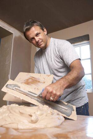 Plasterer Mixing Plaster photo