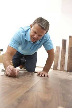 Builder Laying Wooden Flooring Stock Photo - 6452797