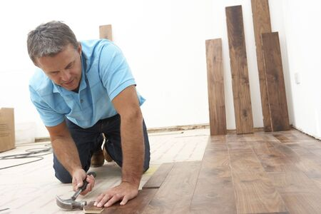 Wood work: Builder Laying Wooden Flooring