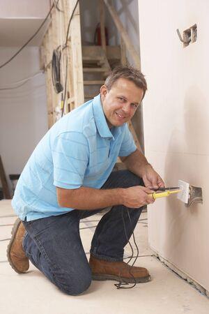 wall socket: Electrician Installing Wall Socket Stock Photo