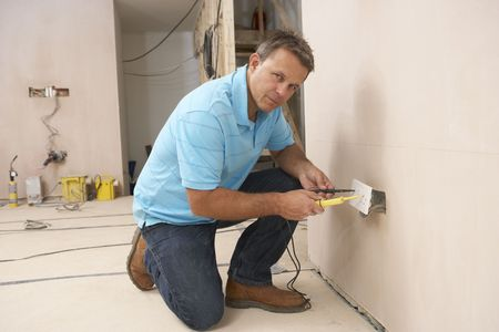 Electrician Installing Wall Socket Stock Photo - 6452617