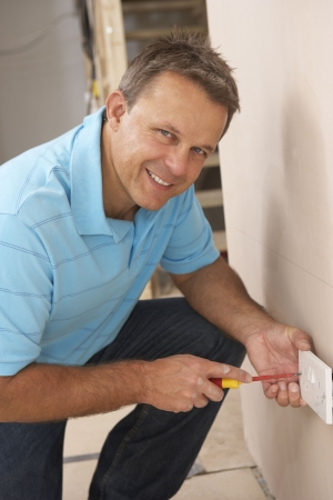 Electrician Installing Wall Socket Stock Photo - 6452712